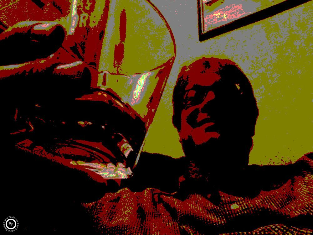 Leaning back, drinking whiskey, all of these images have been de-colorized, the bit numer of colors reduces, I call it posterizing, anyway, blurs it out, gives everything in this image a reddish-yellow hue, just like whiskey, it's a good image